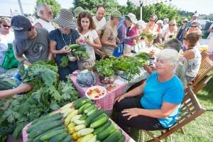 Kathie surveys the crowd at a farmer's market