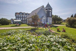 A garden flourishes in the shadow of the island church