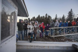 Vinalhaven athletes board Foy Brown's boat to return home.
