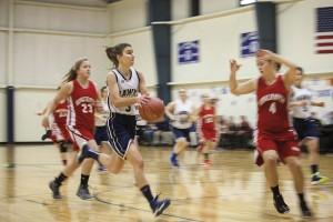 Maddie Hallowell of North Haven drives to the hoop against Vinalhaven.