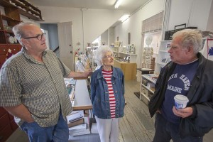 June's son David, at left, with his mother and a customer at the gift shop.