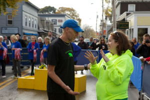 Gary Allen and Mary Ropp confer at the MDI Marathon finish line.