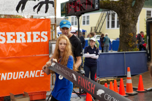 Allen and his daughter Matilda prepare for the finish of the women's half-marathon in Southwest Harbor.