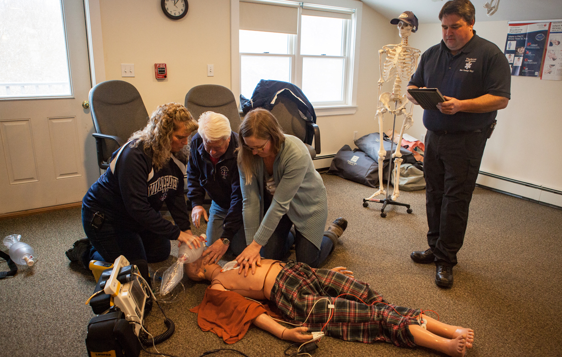 Vinalhaven's EMS volunteers demonstrate how they train to do CPR. From left: Denise Hopkins, Jeff Aronson, Sarah Crossman, and Marc Candage. PHOTO: JACK SULLIVAN