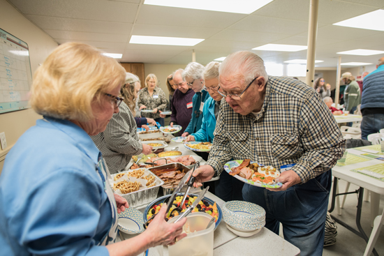 "Though most of the activities fo Harpswell Aging at Home focus on helping the town's oldest residents live independently in their own homes, the ""Lunch with Friends"" series—here, at Bailey Island Union Church—is open to all ages."